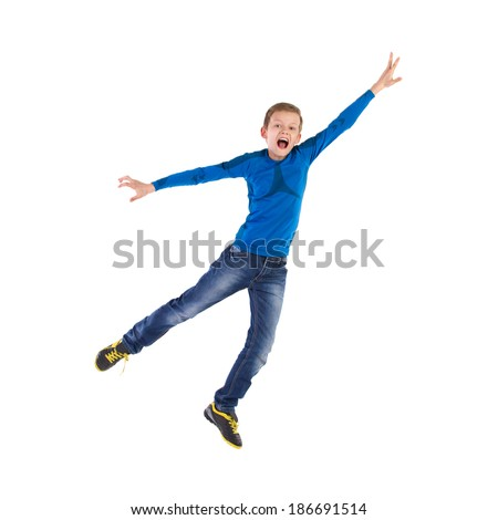 Flying young boy. Jumping young boy with arm raised and mouth open. Full length studio shot isolated on white. - stock photo