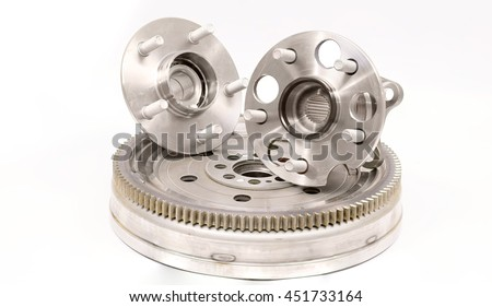 Flywheel damper for automotive diesel engine on a white background and new wheel bearings. Car parts