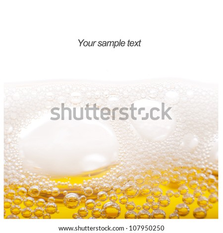 Foam and bubbles of beer to the project. - stock photo