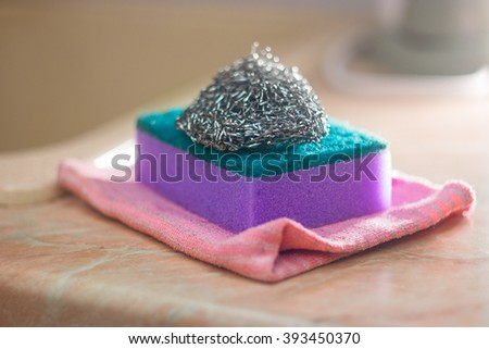 Foam and metal sponges for washing. Selective focus - stock photo