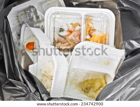foam and plastic food container in the bin / environmental problems - stock photo