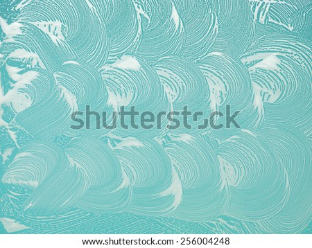foam and soap sud on window surface. abstract pattern - stock photo
