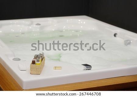 Foam bath in a jacuzzi  - stock photo
