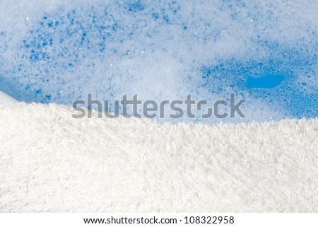 foam , blue water , towel abstract bath background - stock photo