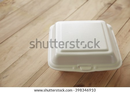 Foam boxes rice on wooden table. - stock photo