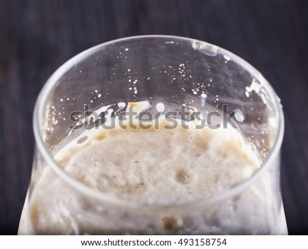 Foam in a glass seen from above, horizontal image