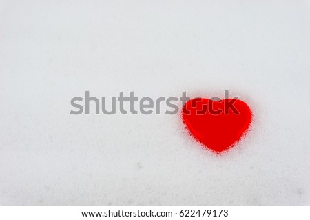 Foam in the bathroom with a heart. Bath with foam and heart background.
