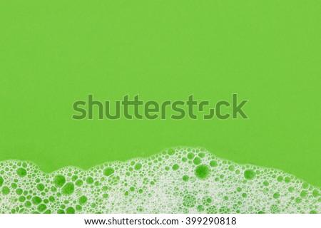 foam on green background macro - stock photo