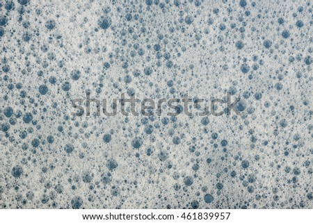 Foam soap bubbles water surface