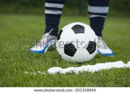 Foam spray free kick half circle with soccer player - stock photo