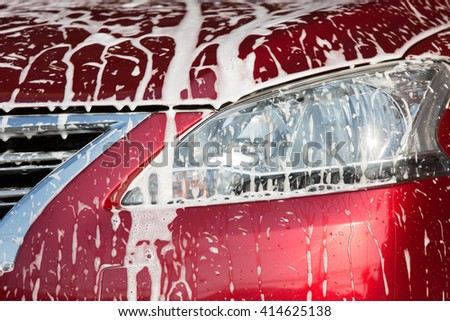 Foam stuck on the car while car wash. - stock photo