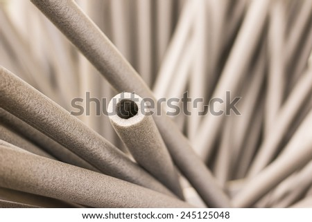 Foam tubes in the warehouse - stock photo