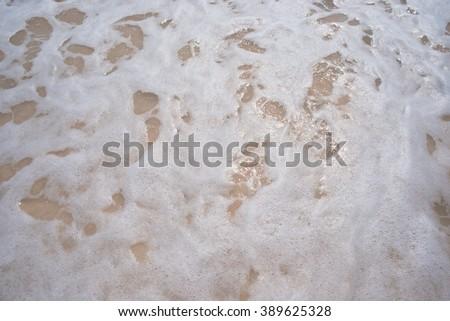 Foamy seawater - stock photo
