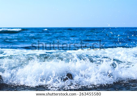Foamy White Wave Crashing On The Rocky Kona Coastline Located On The Island Of Hawaii - stock photo