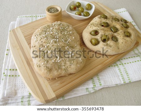 Focaccia bread with olives or rosemary