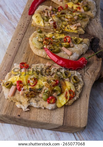 Focaccia with olives, peppers and chicken - stock photo