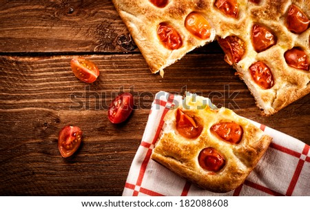 Focaccia with tomato and green olives. Retouching in retro style - stock photo