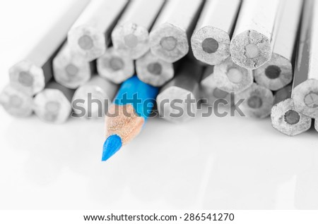 Focus at blue colored pencil with no colored pencil on white background.  - stock photo