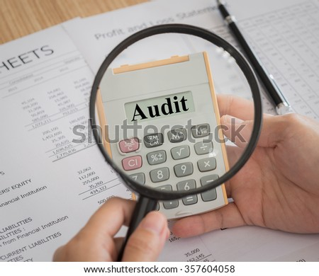 Focus audit on calculator. Concept of business account auditing tax process. - stock photo