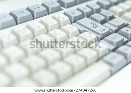 Focus enter Key on Computer keyboard with Japanese characters - stock photo