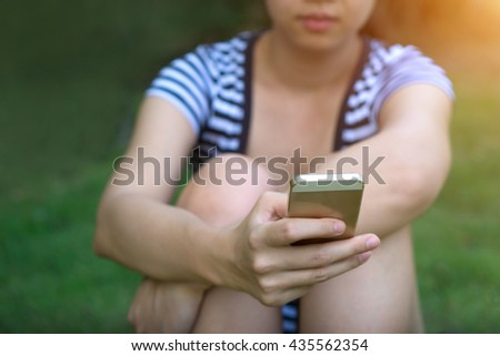 Focus hand of Young asian woman touching smartphone