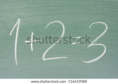 focus of chalkboard and simple math on chalkboard - stock photo