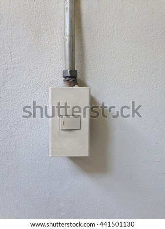 Focus of orange light switch on concrete wall, Concept, On Off, lighting room - stock photo