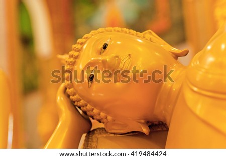 Focus of reclining Buddha statue in temple of Thailand - stock photo