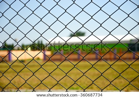 Focus of wired fence with football field