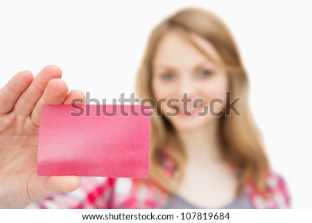 Focus on a loyalty card against a white background - stock photo