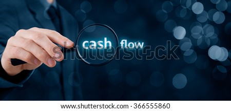 Focus on cash flow and audit of accounts concept. Businessman (auditor) analyze cash flow. Wide banner composition with bokeh in background.