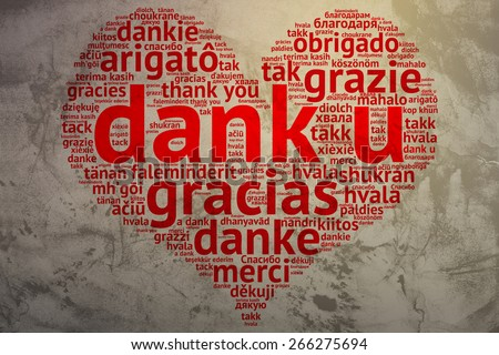 Focus on Dutch: Dank u. Word cloud in heart shape on Grunge Background. saying thanks in multiple languages. - stock photo