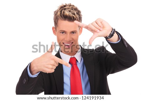 Focus on executive making frame with his hands