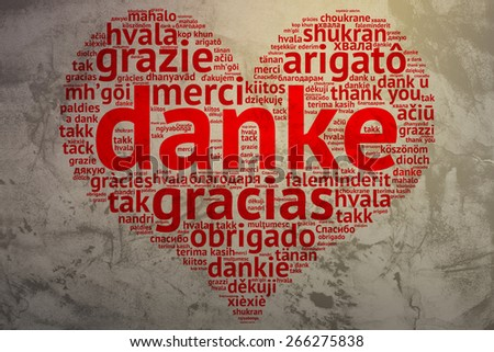 focus on German: Danke. Word cloud in heart shape on Grunge Background. saying thanks in multiple languages. - stock photo
