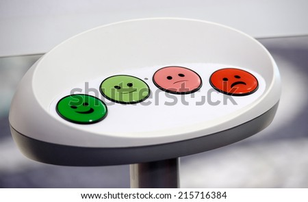 focus on green smile button on a survey  - stock photo