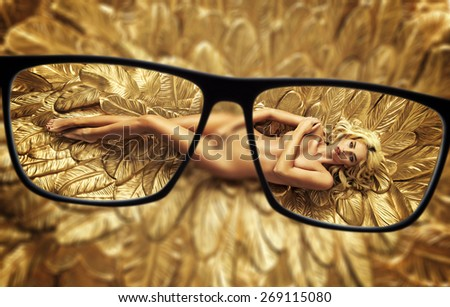 Focus on naked blonde beauty - stock photo