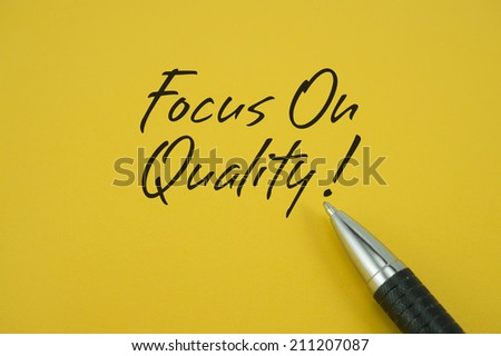 Focus On Quality! note with pen on yellow background