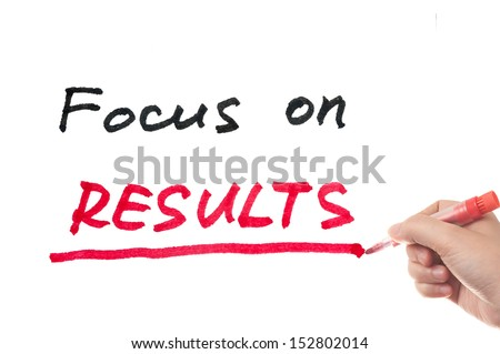 Focus on results words written on white board - stock photo