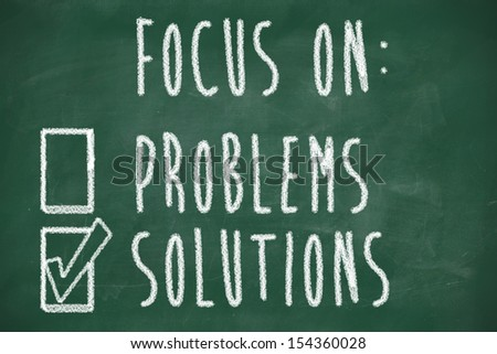 focus on solutions concept, handwritten on blackboard - stock photo