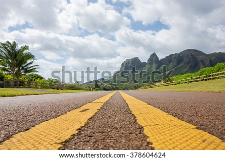 Focus on the road leading to Kalalea mountain on the island of Kauai, Hawaii.  This is the location where King Kong & Raider of the Lost Ark was filmed. - stock photo