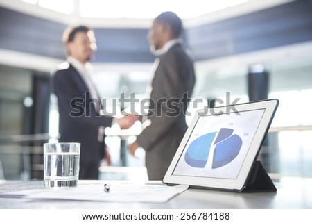 Focus on the things on the table. Blurred people on background. - stock photo
