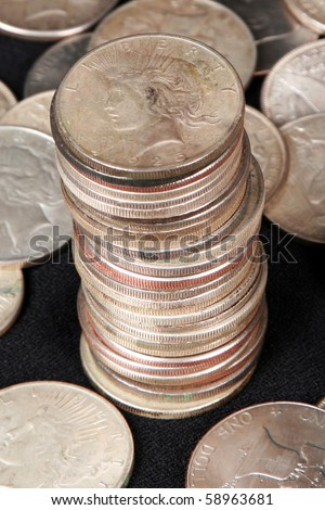 Focus on the top of a stack of silver dollars - stock photo