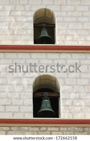 Focus on two of the Santa Barbara Mission bells. - stock photo