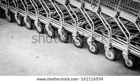 Focus on wheel shopping cart - stock photo
