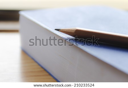 Focus pencil and book - stock photo