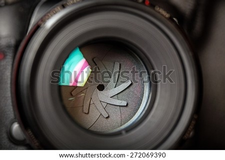 Focus. The diaphragm of a camera lens aperture. Selective focus with shallow depth of field. Color toned image. - stock photo