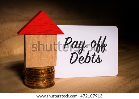 pay off stock images royalty images vectors shutterstock focus written word pay off debts on a white paper a wooden house block stacked