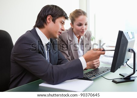 Focused business team working with a computer in an office - stock photo