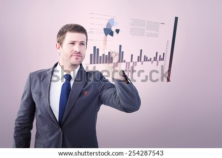 Focused businessman pointing with finger against grey vignette