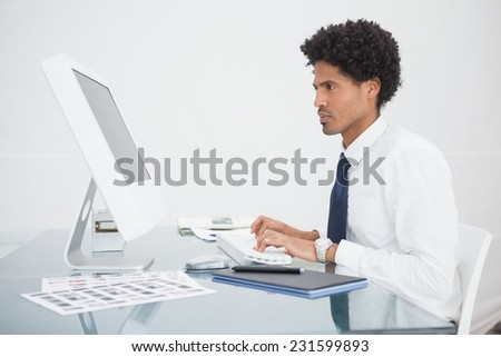 Focused businessman typing on keyboard in the office